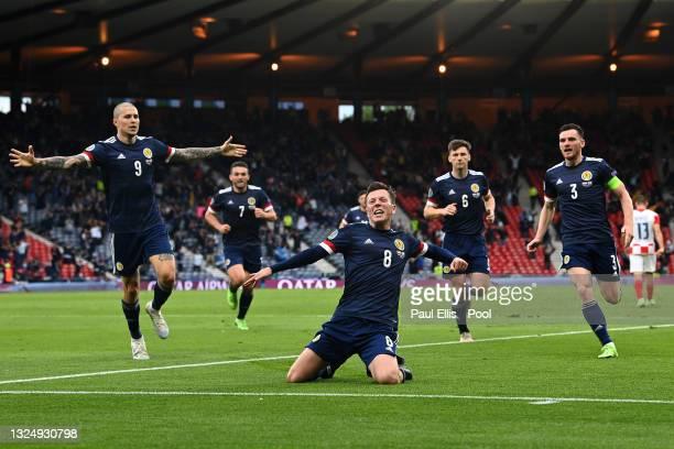 Callum McGregor of Scotland celebrates with teammates Lyndon Dykes, Andrew Robertson, John McGinn and Kieran Tierney after scoring their side's first...