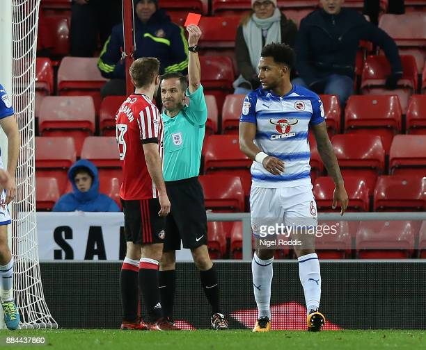 Callum McManaman of Sunderland is sent off by referee Keith Stroud during the Sky Bet Championship match between Sunderland and Reading at Stadium of...