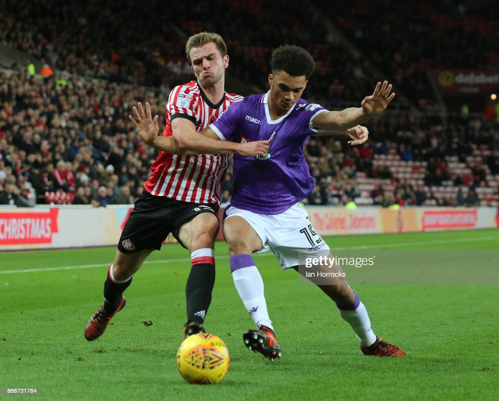 Callum McManaman of Sunderland (L) takes on Antonee Robinson of Bolton during the Sky Bet Championship match between Sunderland and Bolton Wanderers at Stadium of Light on October 31, 2017 in Sunderland, England.