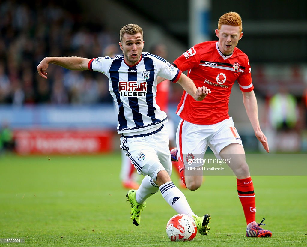Callum McManaman of West Brom holds off Reece Flanagan of Walsall during the Pre-Season Friendly between Walsall and West Bromwich Albion at Banks' Stadium on July 28, 2015 in Walsall, England.