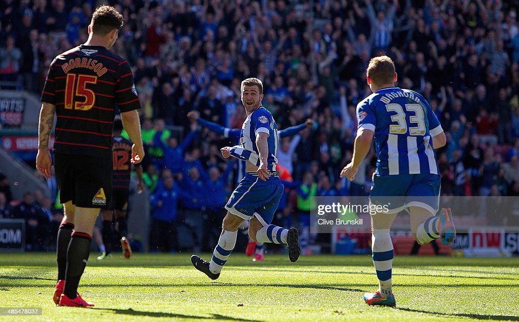 Callum McManaman (C) of Wigan Athletic celebrates scoring his team's third goal during the Sky Bet Championship match between Wigan Athletic and Reading at DW Stadium on April 18, 2014 in Wigan, England.