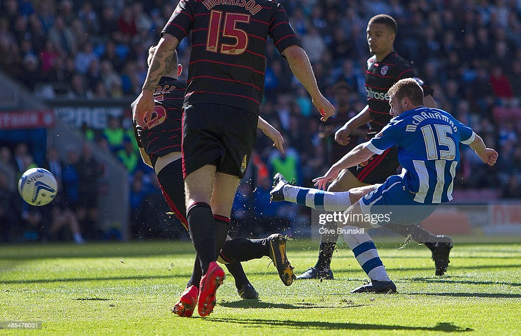 Callum McManaman of Wigan Athletic scores his team's third goal during the Sky Bet Championship match between Wigan Athletic and Reading at DW Stadium on April 18, 2014 in Wigan, England.