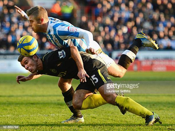 Callum McManaman of Wigan Athletic tangles with Adam Clayton of Huddersfield Town during the FA Cup with Budweiser Fifth Round match between...