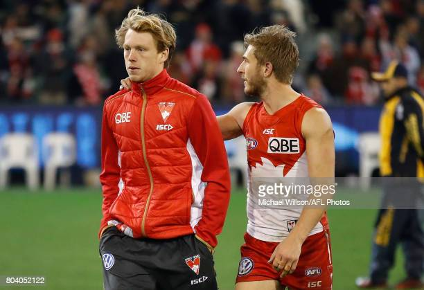 Callum Mills and Kieren Jack of the Swans look on after the 2017 AFL round 15 match between the Melbourne Demons and the Sydney Swans at the...