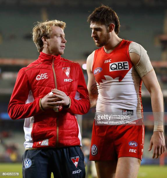 Callum Mills and Sam Naismith of the Swans celebrate during the 2017 AFL round 15 match between the Melbourne Demons and the Sydney Swans at the...