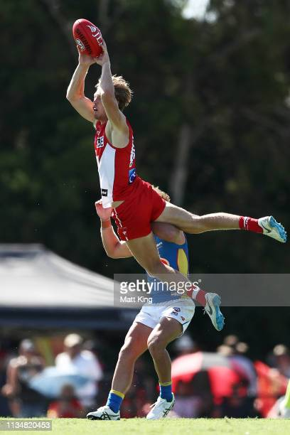 Callum Mills of the Swans attempts a mark during the 2019 JLT Community Series AFL match between the Sydney Swans and the Gold Coast Suns at Oakes...