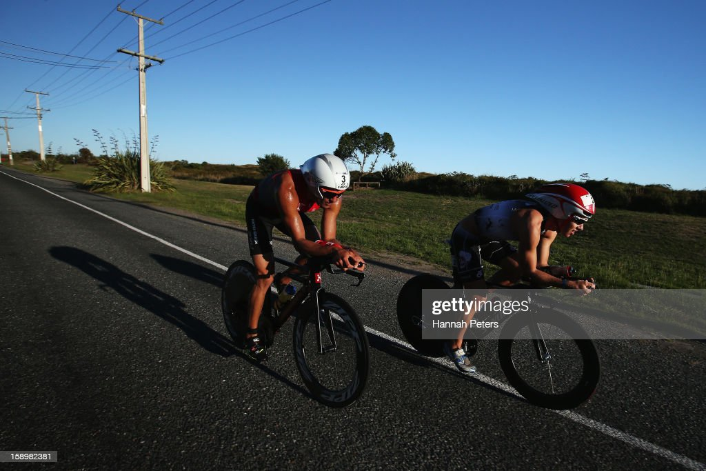 Callum Millward of Havelock North and Terenzo Bozzone of Auckland compete in the Elite Men's race during the Port of Tauranga Half Ironman on January 5, 2013 in Tauranga, New Zealand.