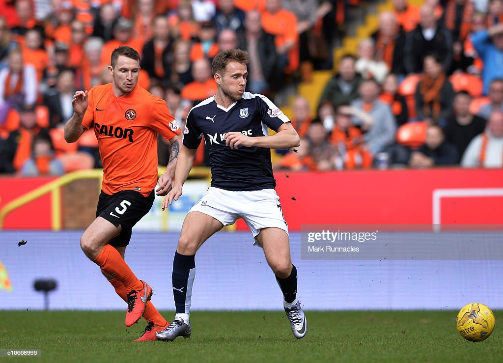 Callum Morris of Dundee United challenges Greg Stewart of Dundee during the Ladbrokes Scottish Premiership match between Dundee United FC and Dundee FC at Tannadice Park on March 20, 2016 in Dundee, Scotland.
