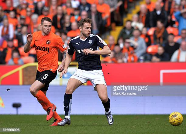 Callum Morris of Dundee United challenges Greg Stewart of Dundee during the Ladbrokes Scottish Premiership match between Dundee United FC and Dundee...