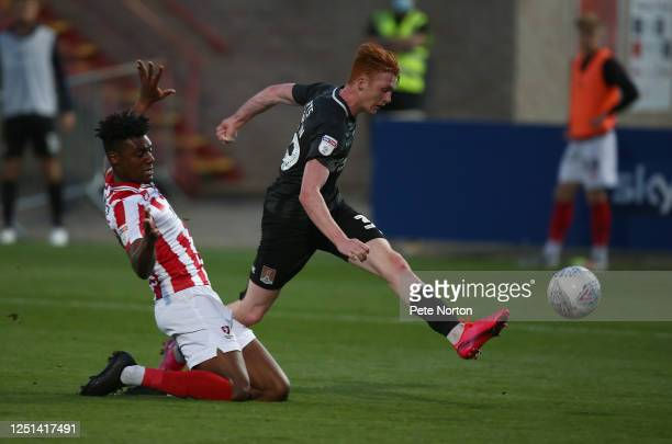 Callum Morton of Northampton Town has a shot at goal under pressure from Rohan Ince of Cheltenham Town during the Sky Bet League Two Play Off...