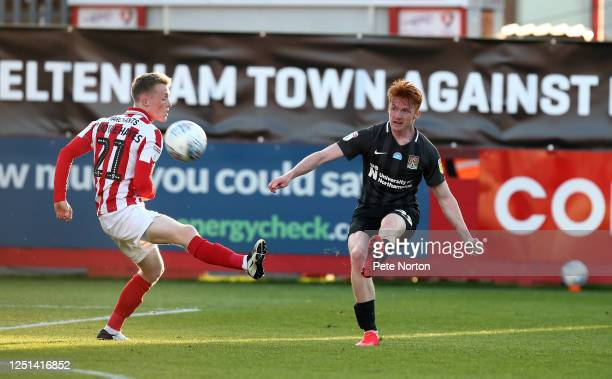 Callum Morton of Northampton Town plays the ball past Jake DoyleHayes of Cheltenham Town during the Sky Bet League Two Play Off Semifinal 2nd Leg...