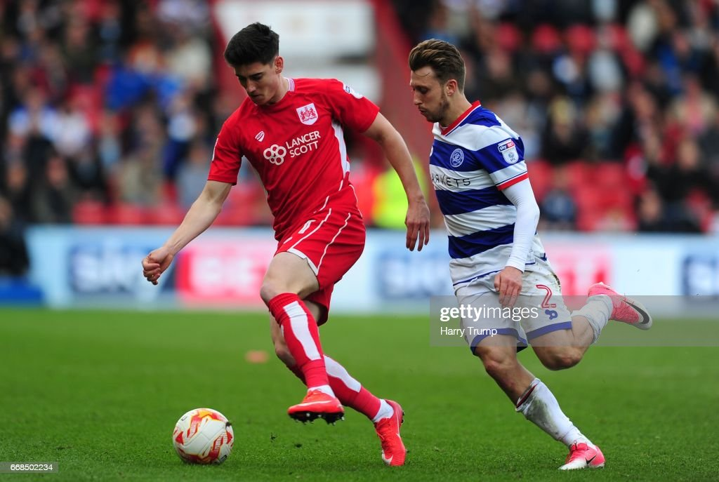 Callum OÕDowda of Bristol City is tackled by Luke Freeman of Queens Park Rangers during the Sky Bet Championship match between Bristol City and Queens Park Rangers at Ashton Gate on April 14, 2017 in Bristol, England.