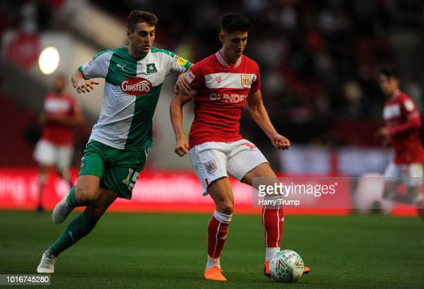 Callum O'Dowda of Bristol City looks to break past Conor Grant of Plymouth Argyle during the Carabao Cup First Round match between Bristol City and...