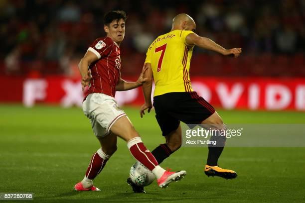 Callum O'Dowda of Bristol City tackles Nordin Amrabat of Watford during the Carabao Cup Second Round match between Watford and Bristol City at...