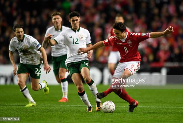 Callum O'Dowda of Ireland vies against Thomas Delaney of Denmark during the playoff FIFA World Cup 2018 qualification football match of Denmark vs...