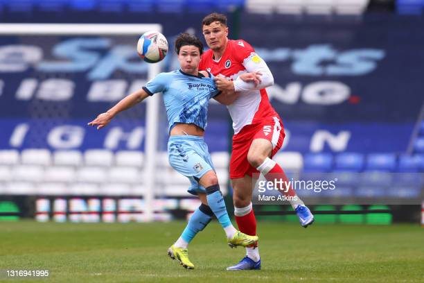 Callum O'Hare of Coventry City battles for possession with Jake Cooper of Millwall during the Sky Bet Championship match between Coventry City and...