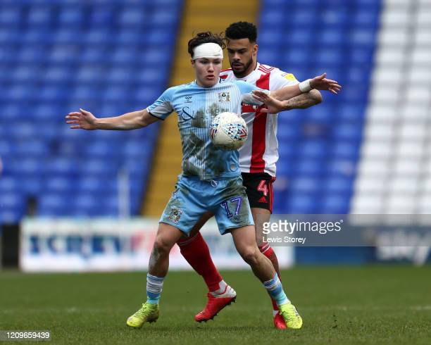 Callum O'Hare of Coventry City comes under pressure from Jordan Willis of Sunderland during the Sky Bet League One match between Coventry City and...