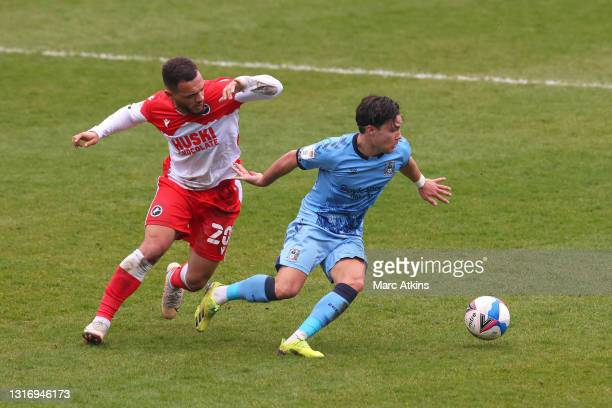Callum O'Hare of Coventry City is put under pressure by Mason Bennett of Millwall FC during the Sky Bet Championship match between Coventry City and...