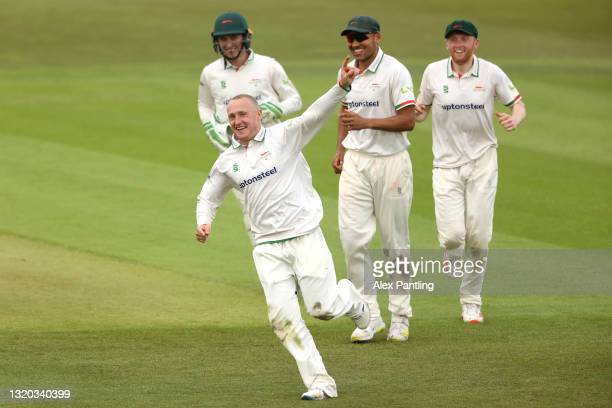 Callum Parkinson of Leicestershire celebrates the wicket of Martin Andersson of Middlesex with team mates Ben Mike and Ed Barnes during the LV=...