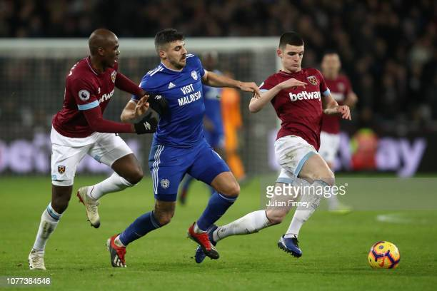 Callum Paterson of Cardiff City battles for possession with Angelo Ogbonna and Declan Rice of West Ham during the Premier League match between West...