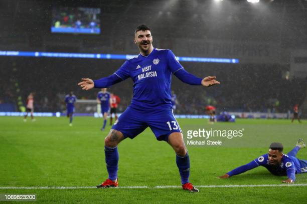 Callum Paterson of Cardiff City celebrates after scoring his team's first goal Josh Murphy of Cardiff City with during the Premier League match...