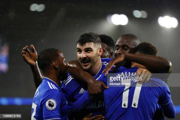 Callum Paterson of Cardiff City celebrates after scoring his team's first goal with his team mates during the Premier League match between Cardiff...