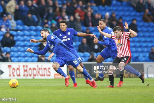 Callum Paterson of Cardiff City falls to the ground after he is tackled by Lynden Gooch of Sunderland during the Sky Bet Championship match between...