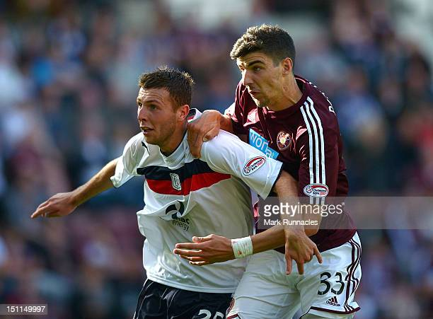 Callum Paterson of Hearts vies with Lewis Toshney of Dundee during the Clydesdale Bank Scottish Premier League match between Hearts and Dundee at...