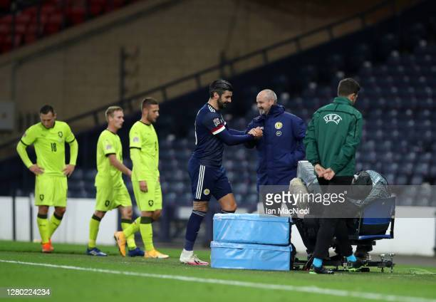 Callum Paterson of Scotland interacts with Steve Clarke Head Coach of Scotland after the UEFA Nations League group stage match between Scotland and...