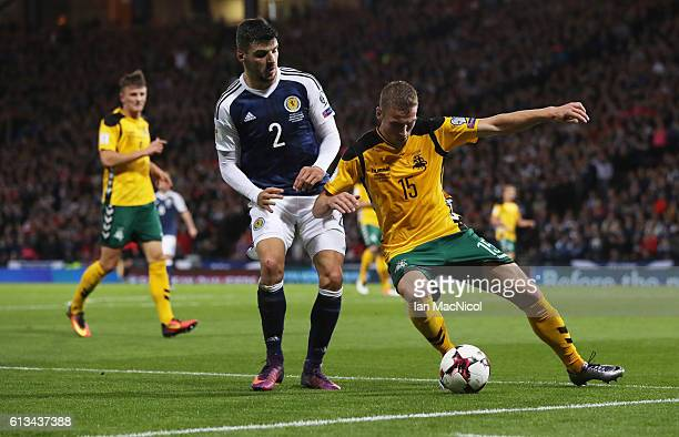 Callum Patterson of Scotland vies with Vaidas Slavickas of Lithuania during the FIFA 2018 World Cup Qualifier between Scotland and Lithuania at...