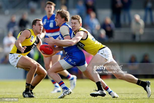 Callum Porter of Footscray is tackled by Jacob Townsend of Richmond during the round 14 VFL match between the Footscray Bulldogs and the Richmond...