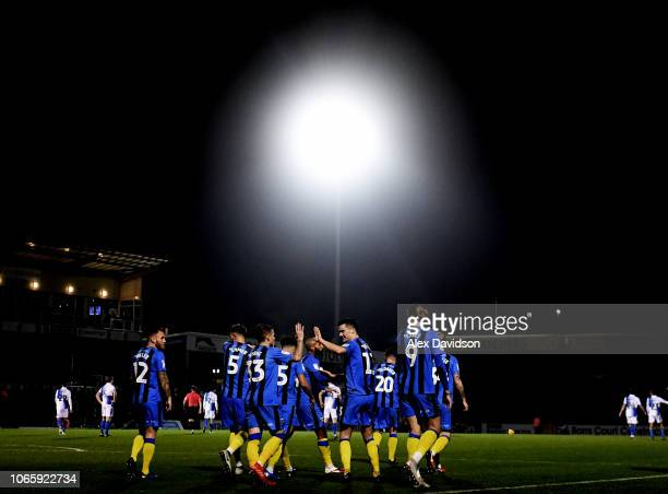 Callum Reilly of Gillingham celebrates scoring his sides second goal with his teammates during the Sky Bet League One match between Bristol Rovers...