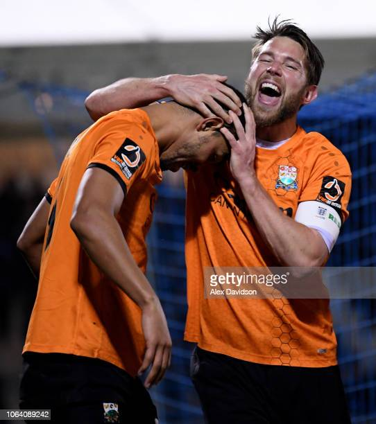 Callum Reynolds of Barnet celebrates with goal scorer Byron Harrison of Barnet during the FA Cup First Round Replay match between Bristol Rovers and...