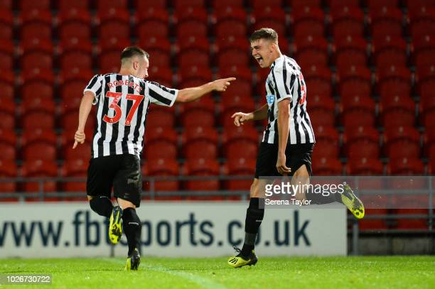 Callum Roberts of Newcastle United celebrates with teammate Elias Sorensen after he scores Newcastle's second goal during the Checkatrade Trophy...