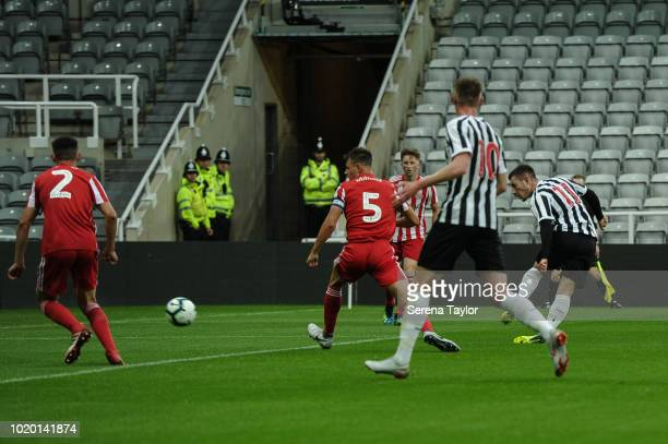 Callum Roberts of Newcastle United strikes the ball and scores Newcastle's second goal during the Premier League 2 Match between Newcastle United and...