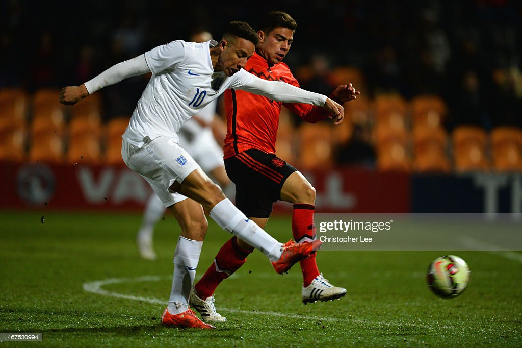 Callum Robinson of England shoots past Oscar Antonio Bernal Lopez of Mexico during the U20 International Friendly match between England and Mexico at The Hive on March 25, 2015 in Barnet, England.