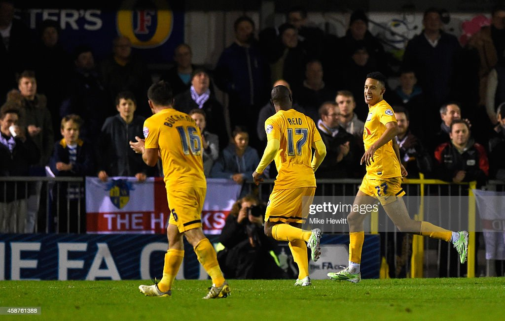 Callum Robinson of Preston (R) celebrates after completing his hat-trick from the penalty spot during the FA Cup First Round match between Havant & Waterlooville FC and Preston North End on November 10, 2014 in Havant, England.