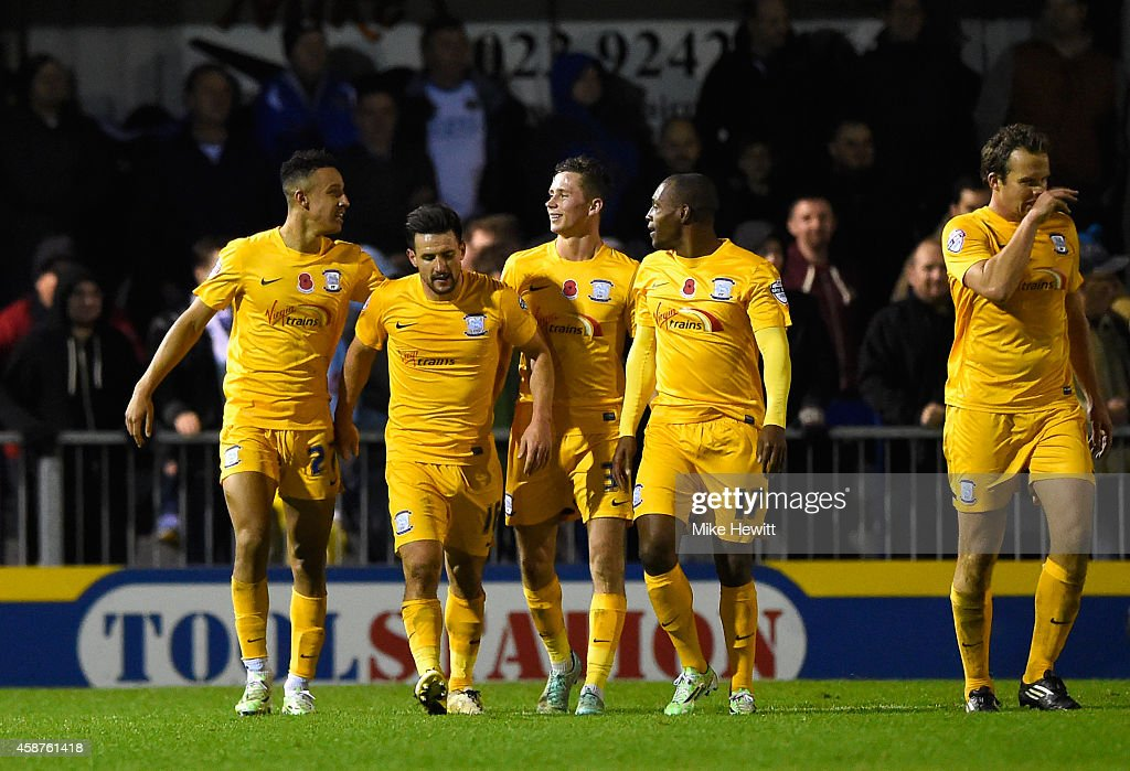 Callum Robinson of Preston (L) celebrates after completing his hat-trick from the penalty spot during the FA Cup First Round match between Havant & Waterlooville FC and Preston North End on November 10, 2014 in Havant, England.