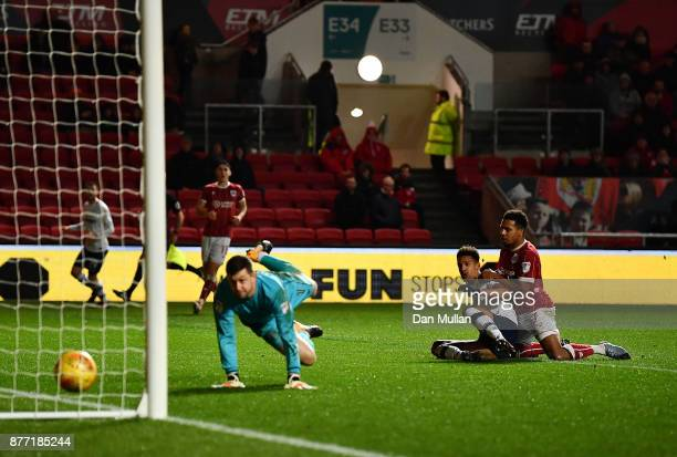 Callum Robinson of Preston North End scores his side's second goal past Frank Fielding of Bristol City during the Sky Bet Championship match between...