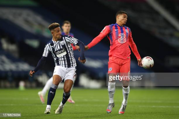 Callum Robinson of West Bromwich Albion battles for possession with Thiago Silva of Chelsea during the Premier League match between West Bromwich...