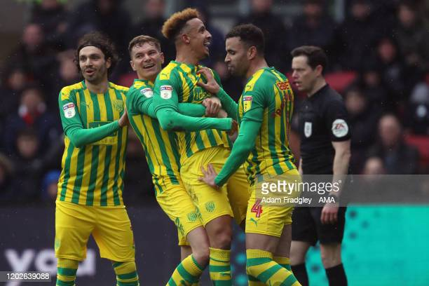 Callum Robinson of West Bromwich Albion celebrates after scoring a goal to make it 01 with Conor Townsend Filip Krovinovic and Hal RobsonKanu during...
