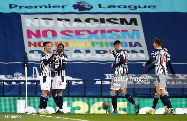 Callum Robinson of West Bromwich Albion celebrates after scoring their sides third goal with team mate Ainsley Maitland-Niles during the Premier...