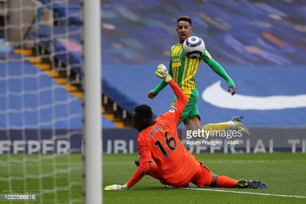 Callum Robinson of West Bromwich Albion chips the ball over Edouard Mendy of Chelsea as he scores a goal to make it 2-5 during the Premier League...