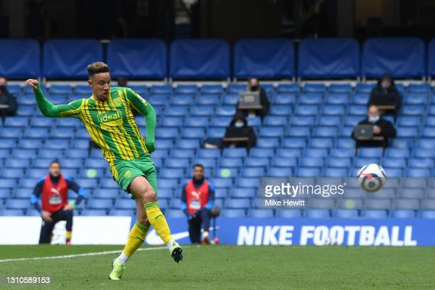 Callum Robinson of West Bromwich Albion scores their team's third goal during the Premier League match between Chelsea and West Bromwich Albion at...