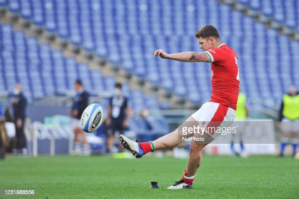 Callum Sheedy of Wales kicks a free kick after scoring a try during the 2021 Guinness Six Nations Rugby Championship match between Italy and Wales at...