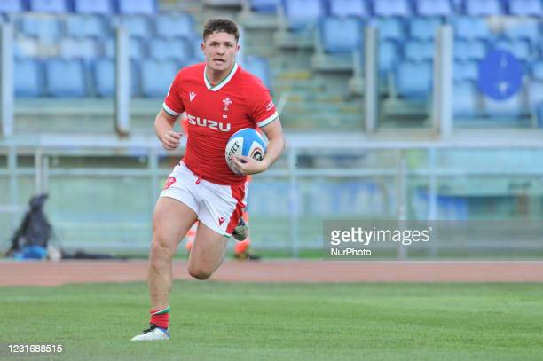 Callum Sheedy of Wales scoring a try during the 2021 Guinness Six Nations Rugby Championship match between Italy and Wales at the Olimpic Stadium in...