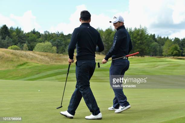Callum Shinkwin and Lee Slattery of Great Britain talk to each other during match 3 of Group A during day two of the European Golf Team Championships...
