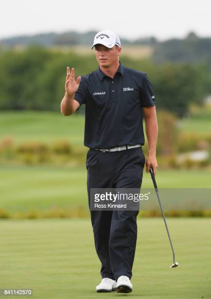 Callum Shinkwin of England acknowledges the crowd after a birdie on the 18th green during day one of the DD REAL Czech Masters at Albatross Golf...
