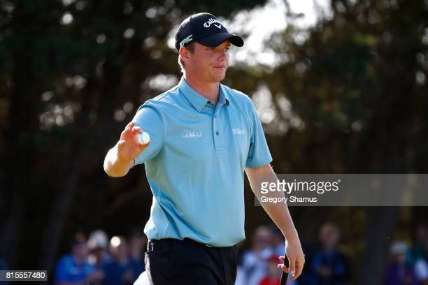 Callum Shinkwin of England acknowledges the crowd on the 16th green during the final round of the AAM Scottish Open at Dundonald Links Golf Course on...