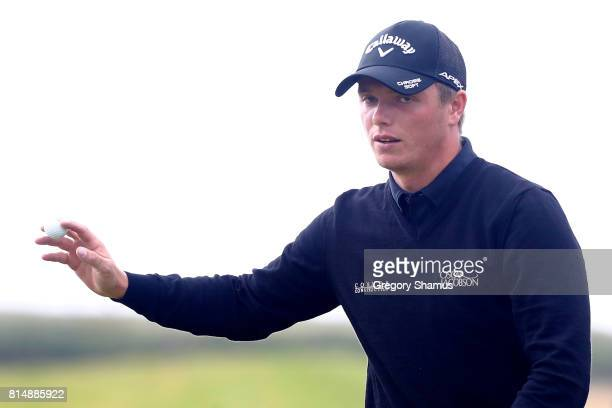 Callum Shinkwin of England acknowledges the crowd on the 17th green during day three of the AAM Scottish Open at Dundonald Links Golf Course on July...